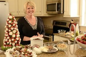 Strawberry Sue making a strawberry Christmas tree