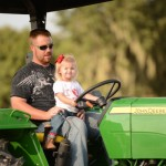 Stevie-with-Dad-on-the-Tractor